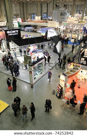 MILAN, ITALY - MARCH 26: People look for cameras, lenses and accessories at PHOTOSHOW, International Photo and Digital Imaging Exhibition on March 26, 2011 in Milan, Italy.