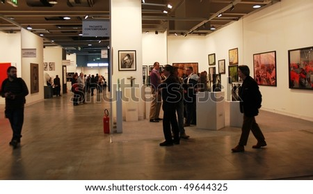 MILAN, ITALY - MARCH 27: People look for exhibition at MiArt ArtNow, international exhibition of modern and contemporary art March 27, 2010 in Milan, Italy.