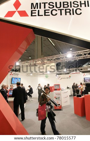 MILAN, ITALY - MARCH 26: People visit Mitsubishi Electric stand during PHOTOSHOW, International Photo and Digital Imaging Exhibition on March 26, 2011 in Milan, Italy.