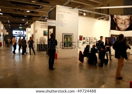MILAN, ITALY - MARCH 27: People visit the exhibition at MiArt ArtNow, international exhibition of modern and contemporary art March 27, 2010 in Milan, Italy.