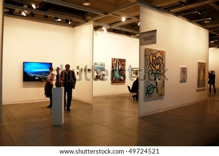 MILAN, ITALY - MARCH 27: People visiting galleries at MiArt ArtNow, international exhibition of modern and contemporary art March 27, 2010 in Milan, Italy.