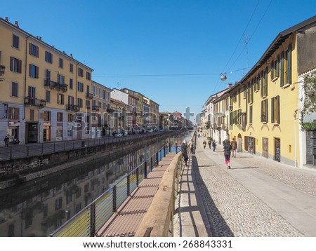 MILAN, ITALY - MARCH 28, 2015: Tourists at the Naviglio Grande canal waterway in Milan Italy - stock photo