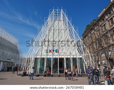 MILAN, ITALY - MARCH 28, 2015: Tourists in front of the Expo Gate information centre in Milan as part of the Expo Milano 2015 international exhibition - stock photo