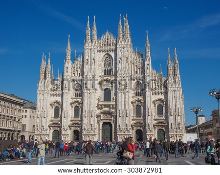 MILAN, ITALY - MARCH 28, 2015: Tourists in the Piazza Duomo square in front of Milan Cathedral church
