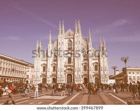 MILAN, ITALY - MARCH 28, 2015: Tourists in the Piazza Duomo square in front of Milan Cathedral church vintage