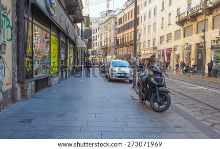 MILAN, ITALY - MARCH 28, 2015: Tourists in Via Torino high street