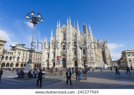 MILAN, ITALY - MARCH 19, 2012: tourists walking and enjoying the view at Milan Dome, a Gothic cathedral that took nearly six centuries to complete. photo taken near Milan Dome on March 19, 2012.  - stock photo