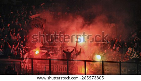 MILAN, ITALY- MARCH 19, 2015: Wolfsburg soccer fans lighting smoke flames to celebrate during the UEFA Europa League match FC Internazionale vs Wolfsburg, at the San Siro stadium, in Milan - stock photo