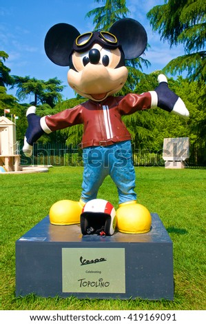MILAN, ITALY - MAY 7: A figure of Mickey Mouse dressed as a typical Italian Vespa rider. The statue is part of an artist exposition at the Triennale in May 7, 2016 at Milan, Italy. - stock photo