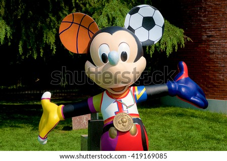 MILAN, ITALY - MAY 7: A figure of Mickey Mouse dressed with various sport subjects is part of an artist exposition at the Triennale in May 7, 2016 at Milan, Italy. - stock photo