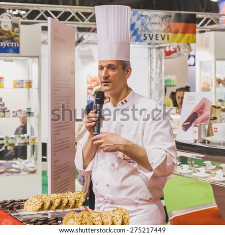 MILAN, ITALY - MAY 4: Chef working at Tuttofood, world food exhibition on MAY 4, 2015 in Milan. - stock photo