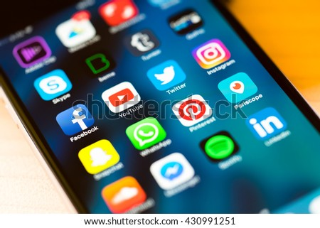 MILAN, ITALY - MAY 27, 2016: Close up of social media app photographed from a smartphone, pleasing defocus due to the inclination. New Instagram icon. - stock photo