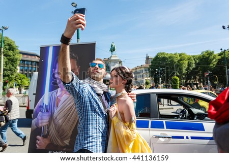 Milan, Italy - May 04 2016: Couple of young people makes selfie during the parade of costumed Star Wars on the street of Luca Beltrami
