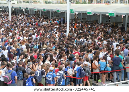 MILAN, ITALY - MAY 29, 2015: Crowd lining up to access Expo exhibition in Milan, Italy. - stock photo