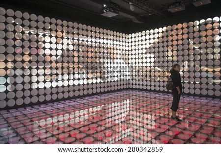 MILAN, ITALY-MAY 04, 2015: food plates displayed on interior lighting room of the Spain pavillion at EXPO 2015, in Milan. - stock photo