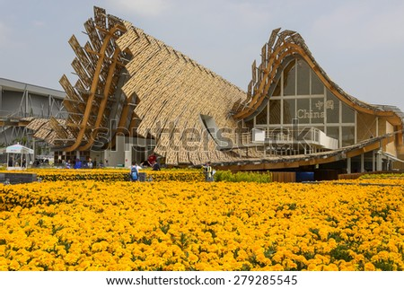 MILAN, ITALY - May 7: foreshortening of China pavilion emerging from a field of yellow flowers , shot  on may 7 2015  Milan, Italy  - stock photo