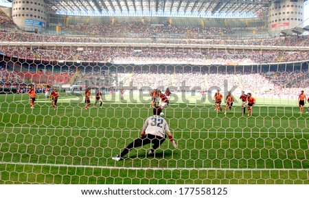 MILAN, ITALY-MAY 16, 2006: Penalty kick view from behind the goal post, during the Italian Serie A soccer match AC Milan vs AS Rome at the San Siro stadium. - stock photo