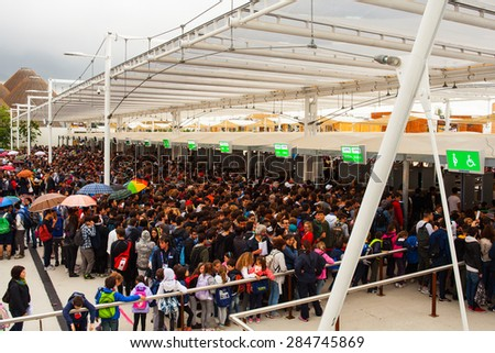 MILAN, ITALY - MAY, 20: People waiting access to Expo, universal exposition on the theme Feeding the planet, Energy for life on May 20, 2015 in Milan - stock photo