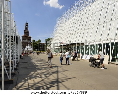 MILAN, ITALY - MAY 30:  the building site of EXPO 2015  tourist information center  near Castello Sforzesco, almost finished, in background the Castle tower, shot  on may 30 2014,  Milan, Italy  - stock photo