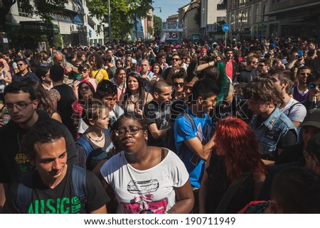 MILAN, ITALY - MAY 1: Thousands of people take part in Mayday parade to celebrate the international Workers' Day on MAY 1, 2014 in Milan.