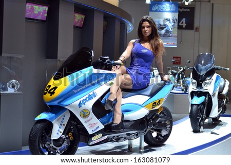 MILAN, ITALY - NOV 12: girl in the stand Polini at EICMA, 71th International Motorcycle Exhibition November 12, 2013 in Milan, Italy