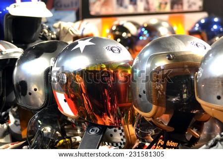 MILAN, ITALY - NOV 8: helmets at EICMA, 72 th International Motorcycle Exhibition November 8, 2014 in Milan, Italy. - stock photo