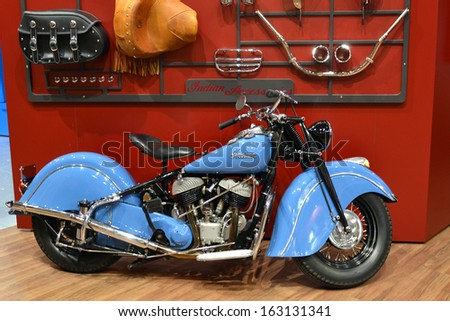 MILAN, ITALY - NOV 5: Indian motorcycles stand at EICMA, 71 th International Motorcycle Exhibition November 5, 2013 in Milan, Italy.  - stock photo