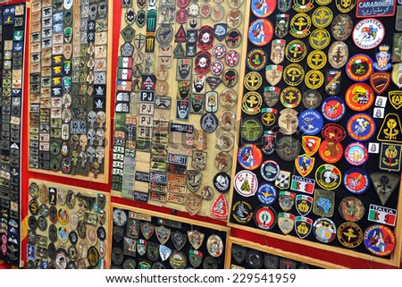 MILAN, ITALY - NOV 1: Military patches, Exhibitor sitting in his stand at Militalia, exhibition dedicated to militaria collectors and military associations on November 1, 2014 in Milan. - stock photo
