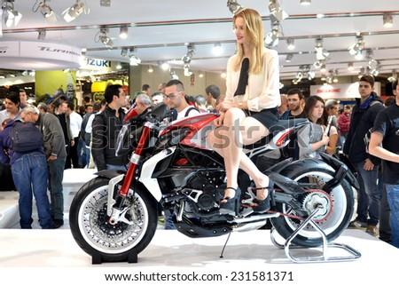MILAN, ITALY - NOV 8: Model at stand MV Augusta  at EICMA, 72 th International Motorcycle Exhibition November 8, 2014 in Milan, Italy. - stock photo
