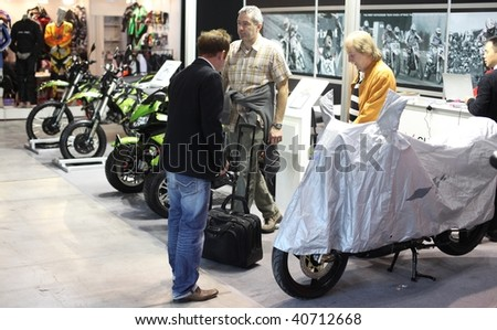 MILAN, ITALY - NOV. 11: People talking about models at EICMA, 67th International Motorcycle Exhibition November 11, 2009 in Milan, Italy.