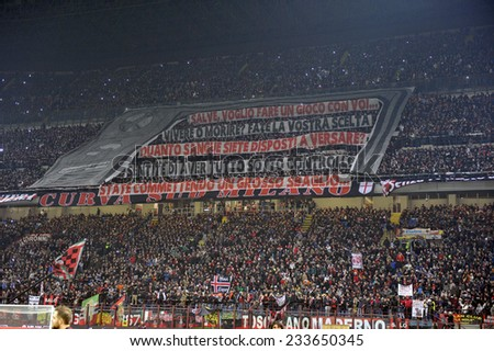 MILAN, ITALY-NOVEMBER 23,2014: AC Milan soccer fans gathering to support their team during the milanese derby AC Milan vs FC Internazionale, at the san siro stadium, in Milan. - stock photo