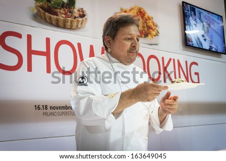 MILAN, ITALY - NOVEMBER 18: Chef shows his creation at Golosaria, important event dedicated to culture and tradition of quality food and wine on NOVEMBER 18, 2013 in Milan. - stock photo
