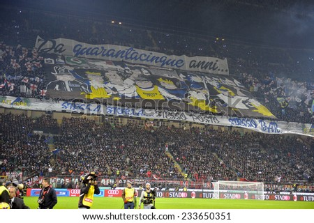 MILAN, ITALY-NOVEMBER 23,2014: FC Internzaionale soccer fans gathering to support their team during the milanese derby AC Milan vs FC Internazionale, at the san siro stadium, in Milan. - stock photo
