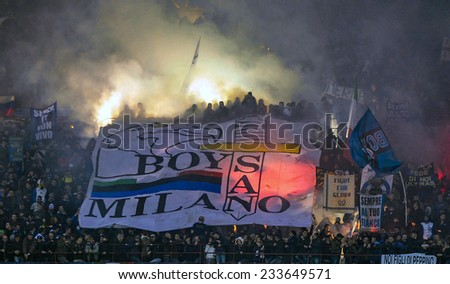 MILAN, ITALY-NOVEMBER 23,2014: FC Internzaionale soccer fans waving flags and lighting smoke bombs during the milanese derby AC Milan vs FC Internazionale, at the san siro stadium, in Milan. - stock photo