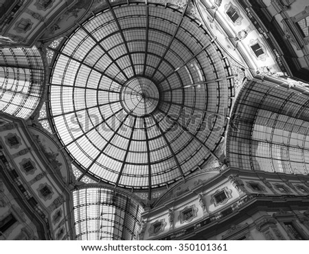 MILAN, ITALY - NOVEMBER 22, 2015: Milan (Lombardy, Italy): the Gallery Vittorio Emanuele II, a covered public place built in 1865-1877. Black and white