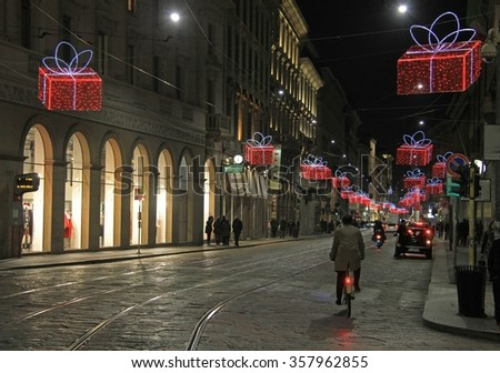 MILAN, ITALY - NOVEMBER 28, 2015: people are walking and riding bicycles on the street in Milan, Italy