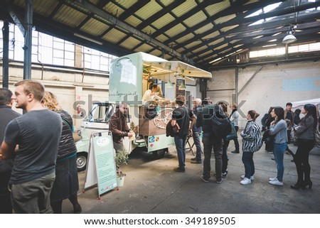 MILAN, ITALY - NOVEMBER 7: People visiting Eat Market, a street food parade with international dishes  in Milan on November, 7 2015. People waiting in line at La Puccia stand at Eat Market - stock photo