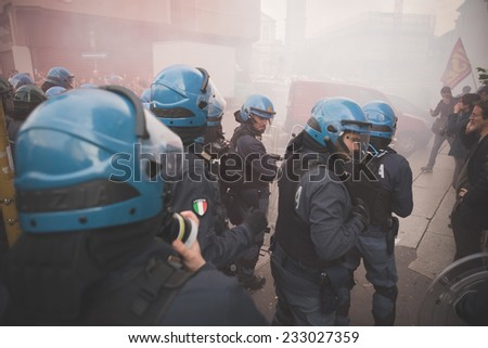 MILAN, ITALY - NOVEMBER 14: Student demonstration held in Milan November 14, 2014. police fighting against students during manifestation