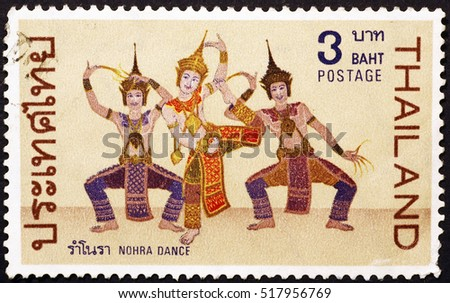 Milan, Italy - November 18, 2016: Traditional thai dancers on postage stamp