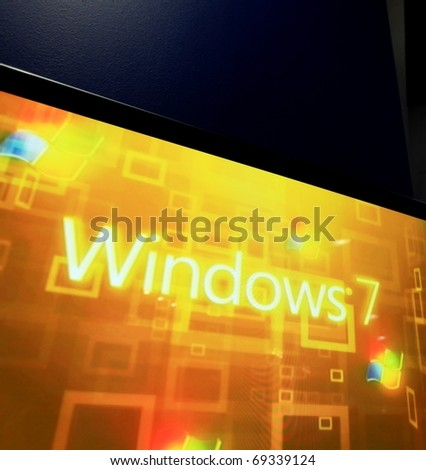 MILAN, ITALY - OCT. 20: Close up of Windows 7 stand at SMAU, international fair of business intelligence and information technology October 20, 2010 in Milan, Italy. - stock photo