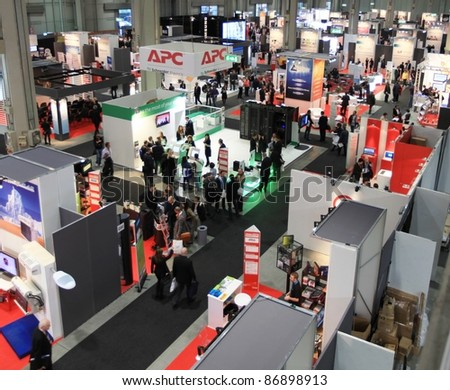 MILAN, ITALY - OCT. 20: Panoramic view of people visiting technologies areas at SMAU, international fair of business intelligence and information technology October 20, 2010 in Milan, Italy. - stock photo