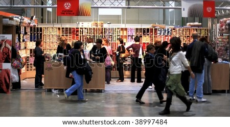 MILAN, ITALY - OCT. 16: People walking trough the stands at Hobby Show, Italian showroom of the fine arts and manual creativity October 16, 2009 in Milan, Italy.