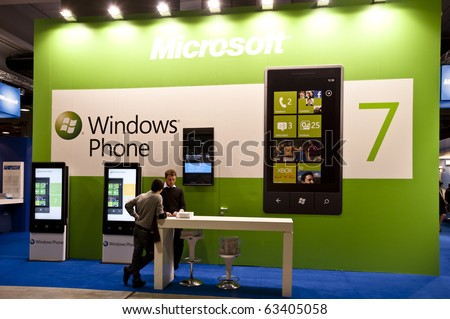 MILAN, ITALY - OCT. 21: Windows Phone desk during SMAU, International Exhibition of Information and Communication Technology on October 20, 2010 in Milan, Italy. - stock photo
