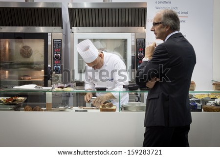 MILAN, ITALY - OCTOBER 18: A chef works in his stand at Host 2013, international exhibition of the hospitality industry on OCTOBER 18, 2013 in Milan. - stock photo