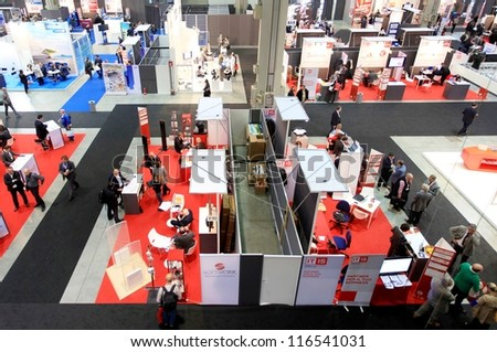 MILAN, ITALY - OCTOBER 17: Aerial view of people visiting products exhibition area at SMAU, international fair of business intelligence and information technology October 17, 2012 in Milan, Italy. - stock photo