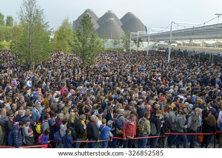 MILAN, ITALY-OCTOBER 07, 2015: crowd of people outside the EXPO gate waiting to visit the international fair dedicated to the food, in Milan.