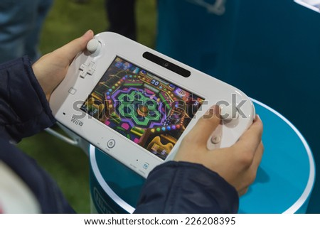 MILAN, ITALY - OCTOBER 24: Detail of Nintendo Wii at Games Week 2014, event dedicated to video games and electronic entertainment on OCTOBER 24, 2014 in Milan. - stock photo