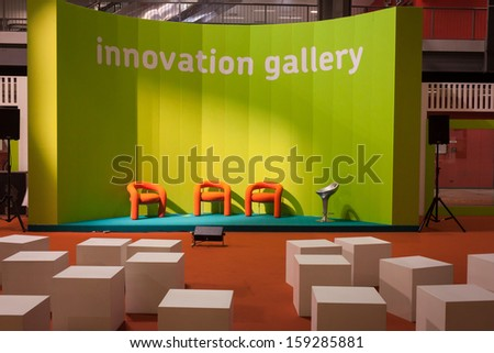 MILAN, ITALY - OCTOBER 18: Empty orange chairs at Host 2013, international exhibition of the hospitality industry on OCTOBER 18, 2013 in Milan.