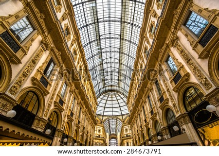 MILAN, ITALY - OCTOBER 14 : Galleria Vittorio Emanuele II on October 14, 2014 in Milan. It's one of the world's oldest shopping malls, designed and built by Giuseppe Mengoni between 1865 and 1877 - stock photo
