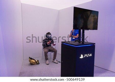 MILAN, ITALY - OCTOBER 14, 2016: Guy tries vitual reality headset at Games Week 2016, event dedicated to video games and electronic entertainment.